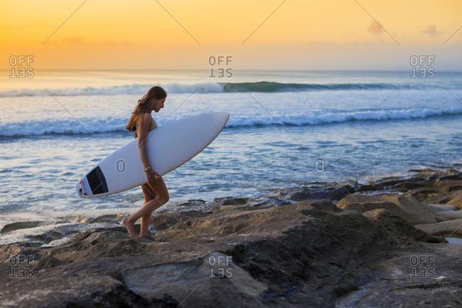 Surfer girl by the ocean