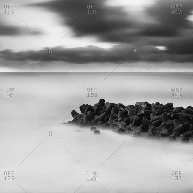 Wave breakers in the sea, Japan