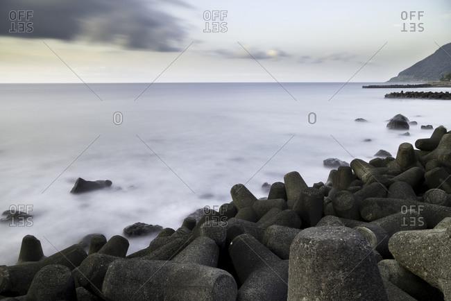 Wave breakers along the shoreline, Japan