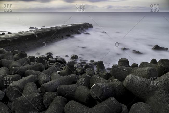 Wave breakers along the shore, Japan
