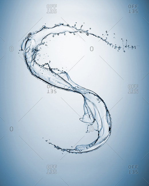 Close up of water slash forming letter S
