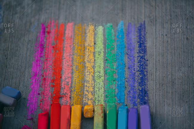 Streaks of sidewalk chalk in a rainbow