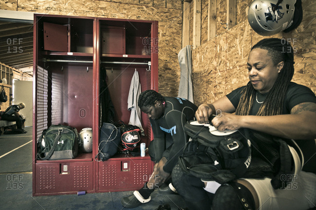 Brooklyn, New York, USA - April 19, 2014: Women in a locker room preparing for a football game