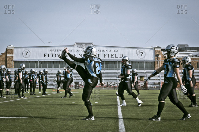 Brooklyn, New York, USA - April 19, 2014: Women warming up before a professional football game