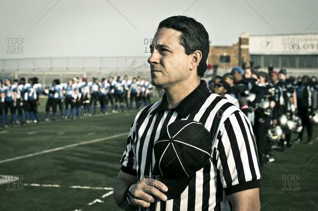 Brooklyn, New York, USA - April 19, 2014: Referee holding his hat over his heart during a women's professional football game