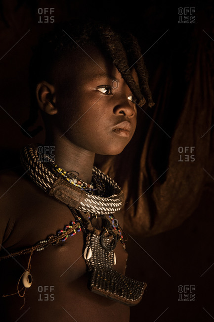 Portrait of a Himba girl in Namibia