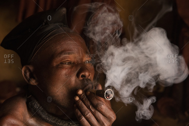 Himba man smoking from pipe