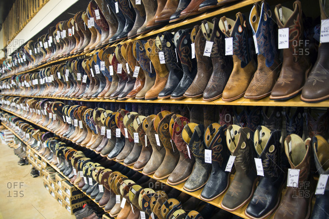 Racks of cowboy boots for sale in Shelby, Montana