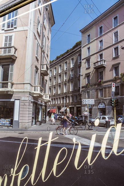 Milan, Italy - June 11, 2015: The reflection of a street in a bakery in Corso Magenta, Milan