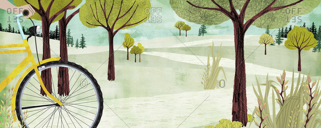 Cyclist in hilly landscape