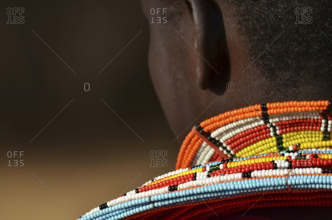 Masai man wearing traditional clothes and adorned with elaborate beadwork jeweler