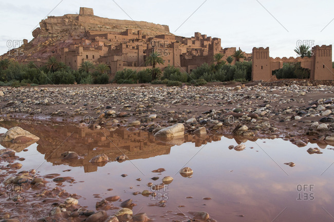 Ait Benhaddou reflected in water, adobe buildings of the Berber Ksar or fortified village, Marrakech