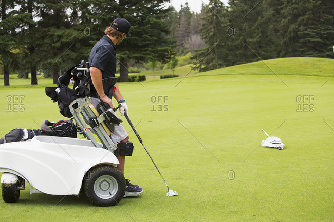Disabled golfer in a tournament using high tech mobility aid, Edmonton, Alberta, Canada