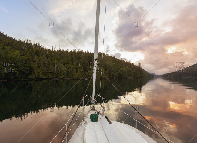 A sailboat at anchor in the setting sun on the west coast of Vancouver Island, Duncan, British Columbia, Canada