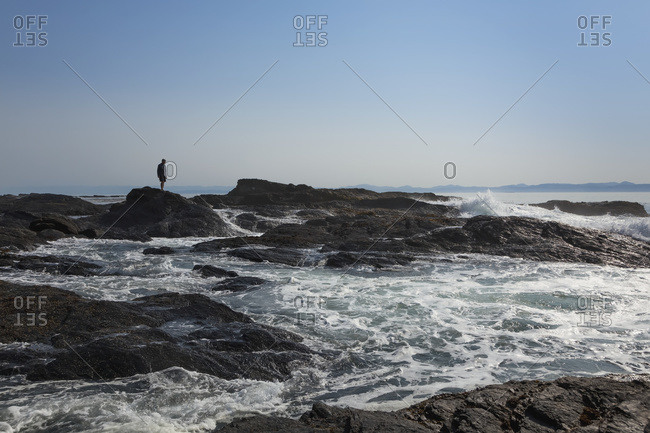 A male hiker at Botanical Beach near Port Renfrew on Vancouver Island, Duncan, British Columbia, Canada