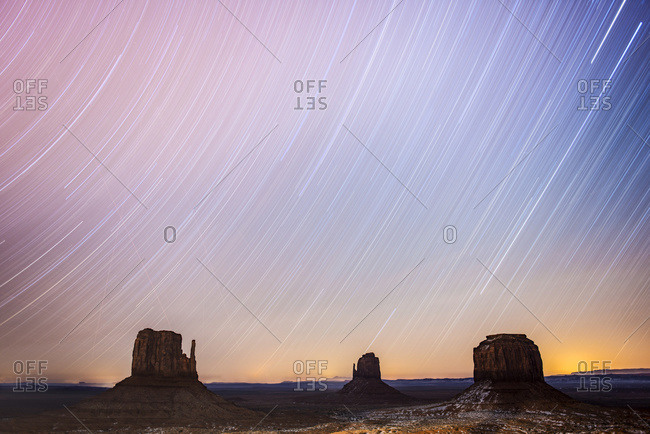 Two-hour star trails capture with The Mittens at Monument Valley Navajo Tribal Park, Arizona, United States of America