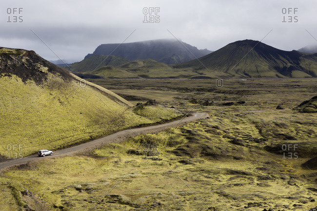 Four wheel drive vehicle driving down a remote road, Iceland