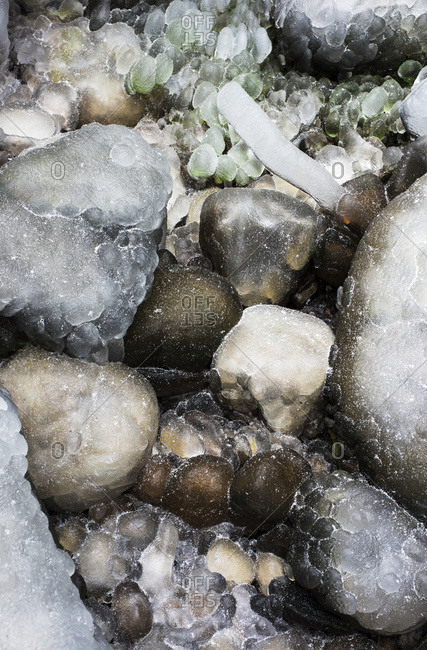 Ice covers the rocks near a waterfall, Olney, Oregon, United States of America
