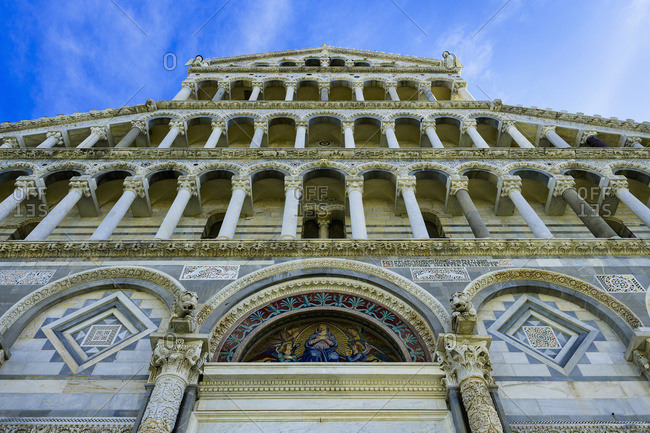 A building with pillars and ornate facade, Pisa, Tuscany, Italy