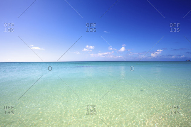 Clear turquoise ocean water towards the horizon and blue sky, Vamizi Island, Mozambique