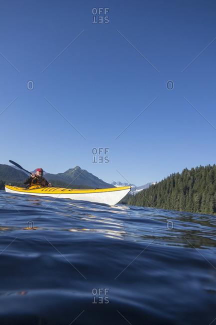 Sea Kayaking on Auke Lake, Mt McGinnis, Mendenhall Glacier and Mendenhall Towers beyond, Juneau Alaska