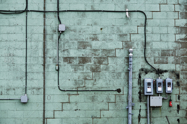 Green cinder block wall with wires, Bickerdike Port in Old Montreal, Montreal, Quebec, Canada