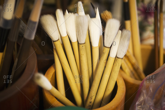 Natural bristle artist brushes in a wooden container for Chinese calligraphy, Gaithersburg, Maryland, United States of America