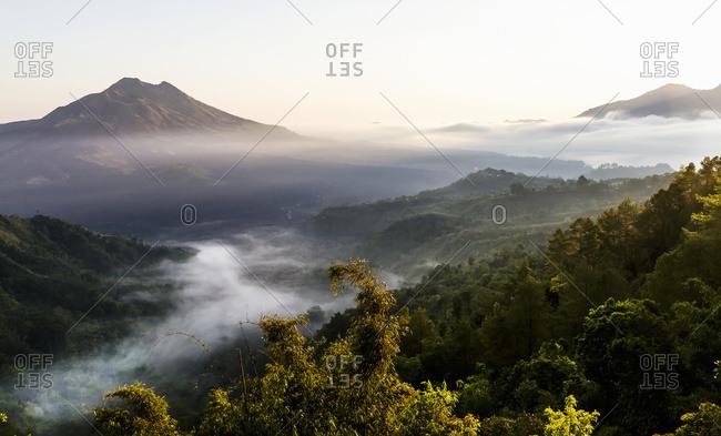 Panoramic view of Mount Batur and Batur Lake at sunrise from Kintamani, Bali, Indonesia