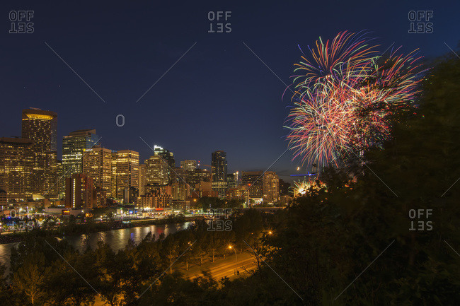 North American city skyline at night, with skyscrapers and fireworks, Calgary, Alberta, Canada