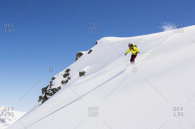 Off piste skier skiing powder, Zinal, Switzerland