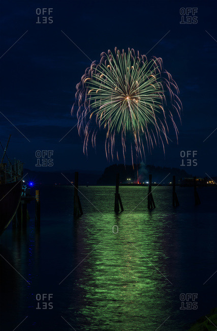 Fireworks explode on the fourth of July, Astoria, Oregon, United States of America
