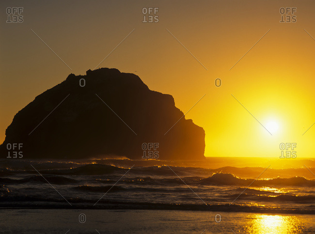 The sun sets near Face Rock, Bandon, Oregon, United States of America