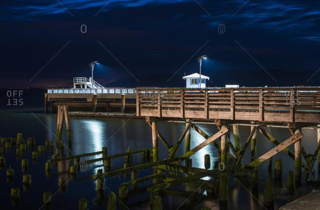 17th Street Pier illuminated on a summer evening, Astoria, Oregon, United States of America