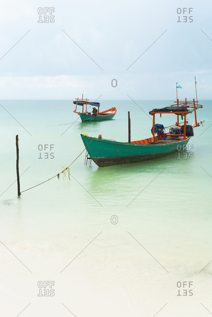 Boats moored in the shallow water off Tui Beach, Koh Rong Island, Sihanoukville, Cambodia
