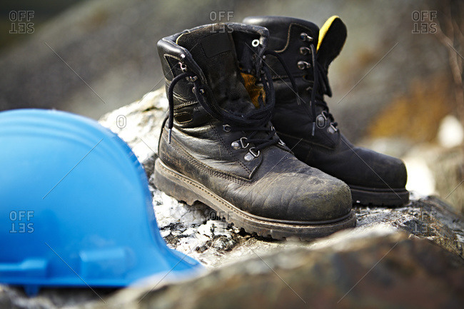 Work boots and a blue hard hat, Quebec, Canada