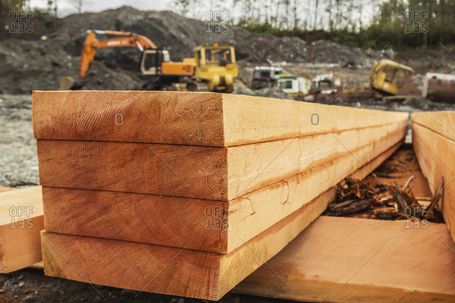 A neat stack of fresh lumber is shown on a side profile revealing the raw grain of the log and texture in the lumber planks ready for construction, Port McNeill, British Columbia, Canada
