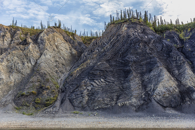 The mountain aptly named Fold Mountain lies along the banks of the Porcupine River, Yukon, Canada