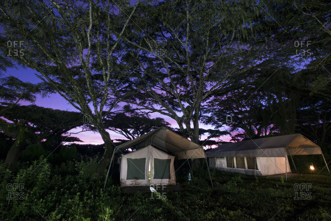Safari camp tents at sunrise on the rim of Ngorongoro Crater, Tanzania