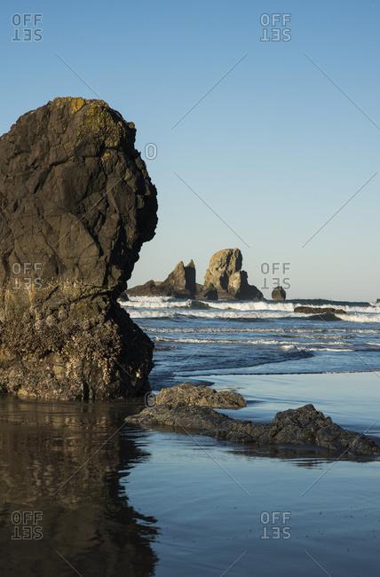 Surf breaks on Crescent Beach, Cannon Beach, Oregon, United States of America