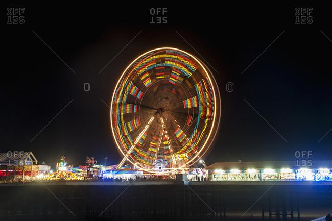 Illuminated colorful ferris wheel, Central Pier, Blackpool, Lancashire, England