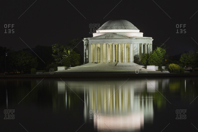Washington, District of Columbia, United States of America - May 11, 2014: Thomas Jefferson Memorial and tidal basin at nighttime, Washington, District of Columbia, United States of America