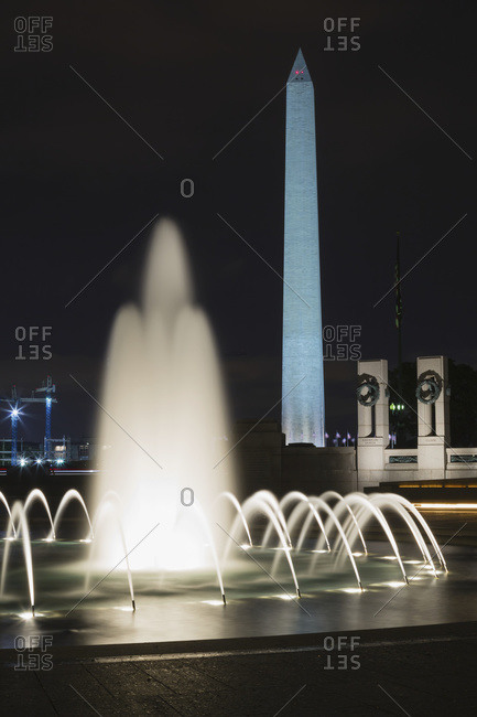 Washington, District of Columbia, United States of America - May 10, 2014: Washington Monument and World War Two memorial at nighttime, Washington, District of Columbia, United States of America