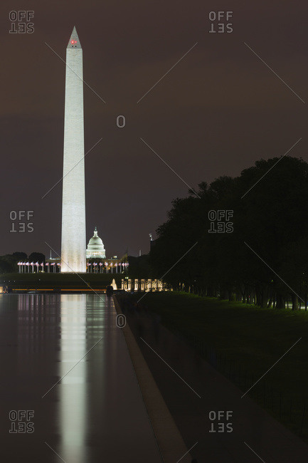 Washington, District of Columbia, United States of America - May 10, 2014: Reflecting pool, Washington Monument and US Capitol at nighttime, Washington, District of Columbia, United States of America