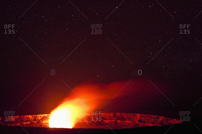 Vivid glow illuminates the Halemaumau Crater of Kilauea Caldera, Hawaii Volcanoes National Park, Island of Hawaii, Hawaii, United States of America