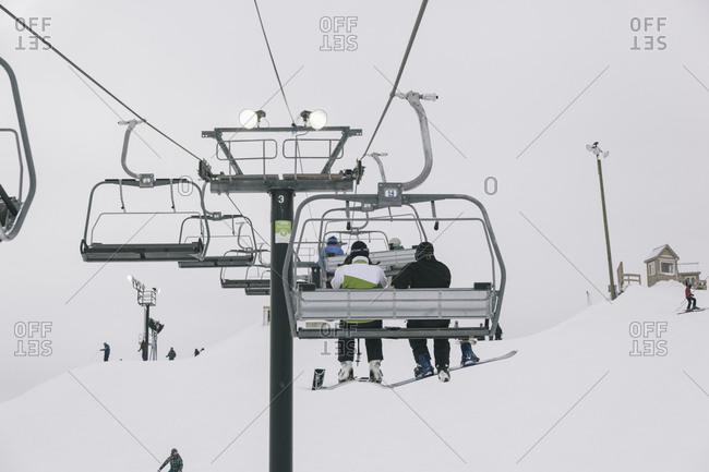 People riding a ski lift