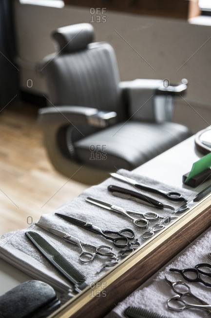 Haircutting scissors rest on towel in barber shop