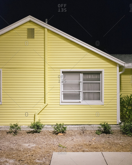Suburban house with yellow siding
