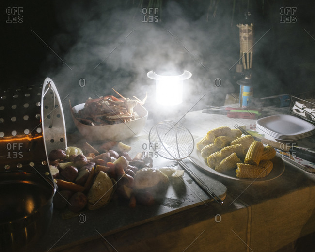 Lantern illuminating a table of food from a crab boil