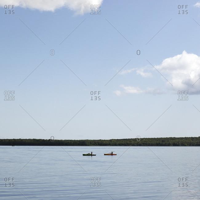 Two women kayaking on a lake