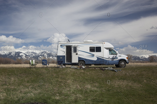 May 13, 2011: Camper van in field with two chairs in Montana